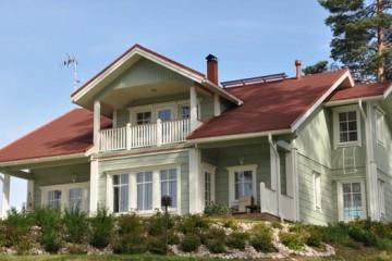Проект двухэтажного финского дома с мансардой, террасой и балконом из клееного бруса
