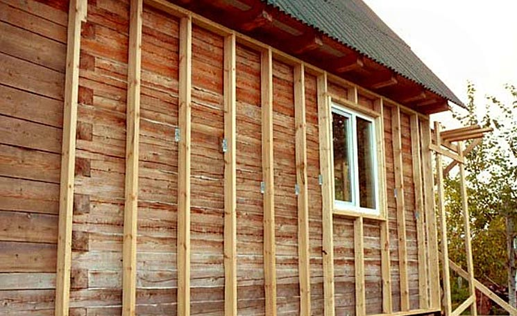 Навесной фасад деревянного дома